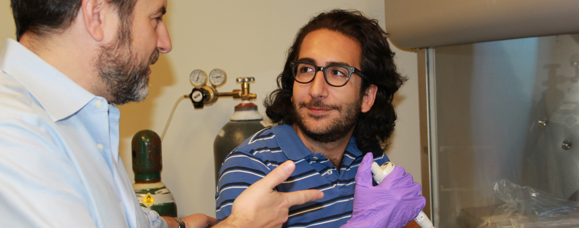 Fellowship recipient Jawad Hoballah works with professor Adam Wax in lab