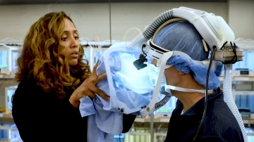 Dr. Melissa Erickson adjusting a 3D SHIELD surgical hood