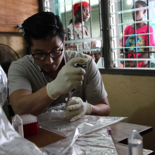 Daniel Joh, an MD-PhD student in BME, prepares serum samples during a field test at the Redemption Clinic in Monrovia, Liberia