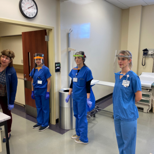 Nursing students demonstrate the face shields