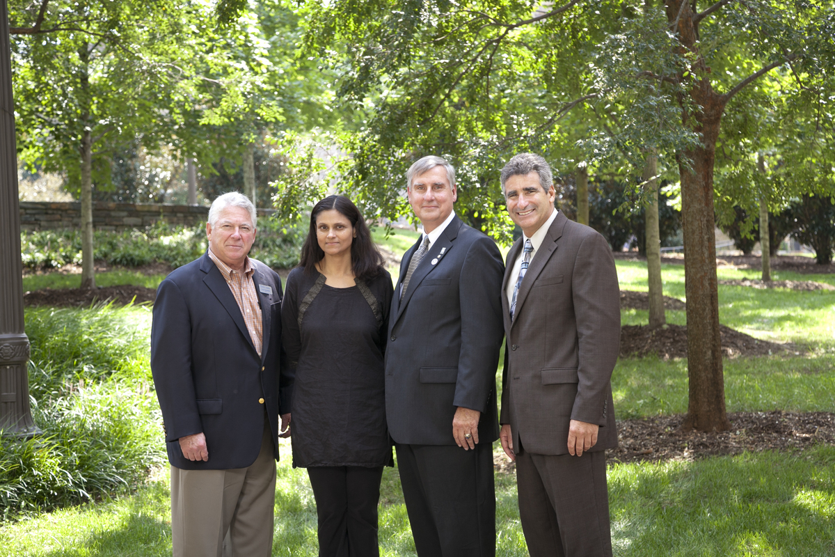Fred Fehsenfeld, Nimmi Ramanujam, Judge Carr and Dean Katsouleas pose after the professorship announcement ceremony