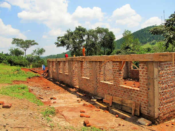 In Uganda, students worked with local engineers and construction crews to design and build a new primary school building. They learned that sometimes all the planning in the world can't fully prepare you when they discovered the site of the building had moved from a flat plain to the side of a hill.